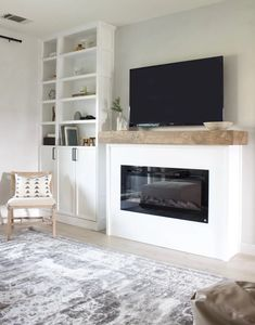 Create your own DIY modern fireplace with an electric insert and a few supplies. A simple project that makes a big impact! Fireplace Frame, Build A Fireplace, Simple Fireplace, Fireplace Built Ins, Home Fireplace, Modern Fireplace, Fireplace Surrounds, Fireplace Design, Diy Faux Fireplace