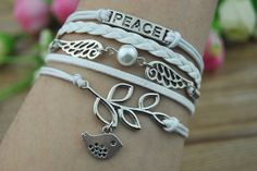 Silver peace wings & white beads leaves and birds by HandmadeTribe, $4.99 Simple fashion handmade leather bracelet,the best gift of friendship.