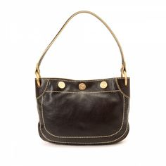 e93d758fb7c6 LXRandCo guarantees this is an authentic vintage Céline handbag. This  classic purse was crafted in leather in beautiful dark brown.
