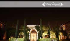 Villa Siena lit up under the night sky surrounded by beautiful landscaping | Darly Elizabeth Photography | villasiena.cc