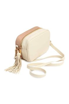 Small shoulder bag in imitation leather with one smooth side and one grained side. Zip at top, decorative tassel at one side, and detachable shoulder strap. Size 3 x 4 x 7 in. Side Purses, Small Shoulder Bag, Shoulder Strap, Side Bags, Girls Bags, Mode Vintage, Luxury Bags, Small Bags, My Bags