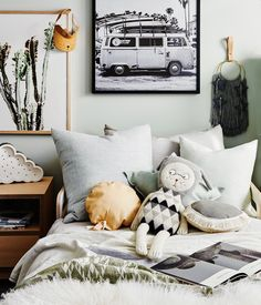 Harvey's Bedroom   Photographer: Lisa Cohen Stylist: Beck Simon  Paint: Dulux Spanish Olive Carpet: Godfrey Hirst  Door: Corinthian Doors  Products:  Surf Bus Print, Donna Delaney Cactus Print, Honey Honey Wall hanging, Felix Furniture Side Table (all available at www.norsu.com.au)