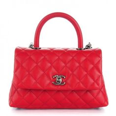 1f405ac8105 This is an authentic CHANEL Caviar Quilted Mini Coco Handle Flap in Red.  This sleek