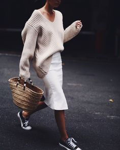 Oversized sweater tucked into pencil skirt, worn with sneakers and a big tote. Blush and white combo.