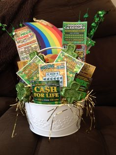 St. Patrick's Day themed basket with $100 of scratch-off lottery tickets and a rainbow wall hanging.  Sold tickets $5 each.