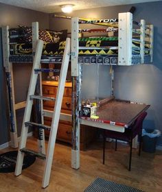 "Hockey Stick Loft Bed built by Don M. ""I recently finished designing and constructing a rugged-looking hockey themed loft for my son that incorporated 103 hockey sticks and 22 pucks."""
