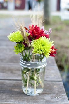 Mason jars with flowers. Cleopatra Photography