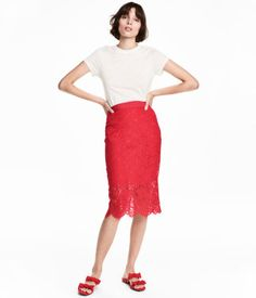 Red. Calf-length pencil skirt in lace with grosgrain ribbon at waist, concealed zip and button at side, and slit at back. Lined.