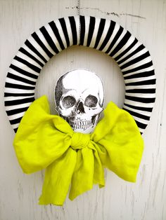 Perfect wreath for Halloween.  Striped wreath, large chartreuse bow & skull.