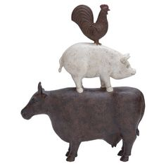 Animal statue with stacked cow, pig, and rooster design.   Product: DécorConstruction Material: Polystone