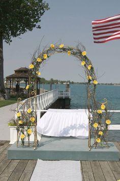 wedding arch: yellow daisies