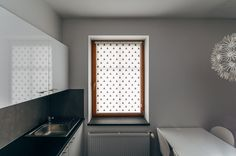 Black TRIANGLE mini roller blind by MOTIVO. Simple and beautiful
