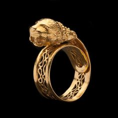 Estate 22Kt Yellow Gold Lion Head Band Ring.The ring is 7mm wide, currently a size 7 (fully adjustable), and it weighs 7.6 grams.