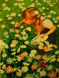 So sweet! Little girl painting daisies. A great metaphor for life...sometimes we have to color our own world, learn to make our own beauty, be unique, and bloom where we are planted...making the best of things.  I wonder if this would really work? If so it would be a really cute photo to try!