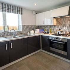 This stylish monochrome kitchen is bang on trend thanks to its glossy units and subtle downlights. Discover this room in the 'Aldenham' at Spring Walk in Willenhall Taylor Wimpey, New Homes For Sale, First Home, Downlights, Monochrome, Attitude, Dj, Kitchens, Sweet Home