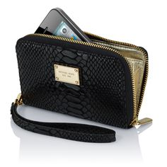 MICHAEL Michael Kors Essential Zip Wallet for iPhone  $89 The pocketbook style Essential Zip Wallet offers a three-side zippered opening and two-side gold webbing. Its inner protective device pouch is perfect for hiding your iPhone inside. And the durable gold color metal zip closure keeps your iPhone and other necessities in the credit card pockets snugly in place.  Black snake leather