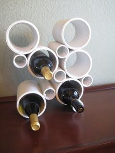 If you enjoy modern decor, embrace PVC pipe's industrial look by crafting an abstract wine holder that's sure to be a conversation piece. Click through for the tutorial and more DIY PVC pipe organizers. Pvc Pipe Storage, Wine Storage, Yarn Storage, Pvc Pipe Projects, Storage Hacks, Storage Ideas, Storage Solutions, Wine Bottle Holders, Bottle Rack