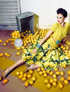 Example of props: The props in this image are very simple, they are lemons and a crate. Though they are simple they add a great amount of interest in the photo. They help add dimension, and they tie into the yellow color story. It is a great example of how using a few simple props can really transform an image.