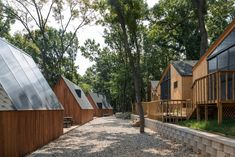 Exterior, Cabin Building Type, Shed Building Type, Gable RoofLine, and Wood Siding Material Photo 7 of 11 in A Camping Village in South Korea Draws Inspiration From an Iconic Fairy Tale Cafe Design, House Design, Farm Village, Wellness Resort, Social Housing, Wood Siding, Bus, River House, Prefab