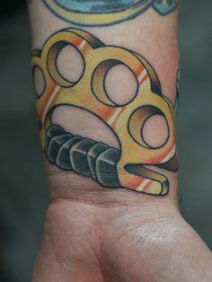 Brass Knuckles tattoo by Matt Stankis. Wilmington, DE