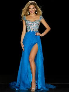 Bring your own unique taste in pageant evening wear to the stage sporting the beautiful Mac Duggal teen pageant dress 42954P! This lovely dress features cap sleeves that are attached to a sweetheart neckline bodice that are all covered in an array of multi colored Swarovski crystals hand sewn into a floral inspired pattern that also covers the back of this dramatic dress. The skirt is layers of silk and features a split and a long wide train.