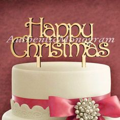 aMonogramArtUnlimited Happy Christmas Wooden Cake Topper Color: Silver Glitter