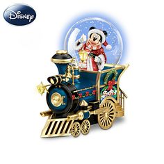 "Disney Mickey Mouse Christmas Musical Locomotive Snowglobe Disney Santa Mouse Is Comin' To Town Miniature Snowglobe A Bradford Exchange first, with Disney's Mickey Mouse inside a real working snowglobe. Sculpted locomotive, authentic Disney art, plays holiday music. Measures 4-1/2"" W Price: $24.99"