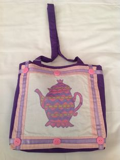Small  tea pot bag for a child. In purple fabric and muslin with tea pot painted in pink, purple paint . decoration pink buttons and ribbon.