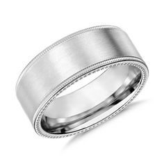 Contemporary in design, this 8 millimeter 14k white gold wedding band features a milgrain edge for a more modern look.