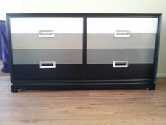8 Drawer Dresser, newly painted with a high gloss white, two shades of grey, and black paint giving it a nice, modern, ombre look! Handles are painted in a high gloss silver paint.