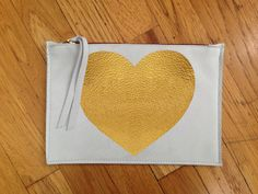 Leather zippered pouch in White color leather  with painted Heart in gold. by NotRational on Etsy https://www.etsy.com/listing/179372057/leather-zippered-pouch-in-white-color