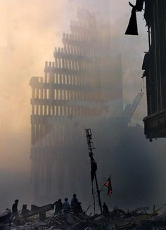 Still Standing  Portions of the towers' facades remained upright, creating the effect of a cathedral in the mist.  Photo: AP/Shawn Baldwin