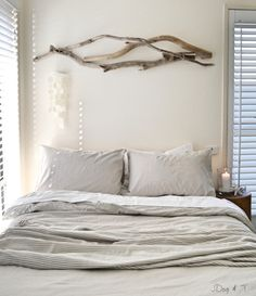 Driftwood wall art by JDog & T Interiors. Eco friendly home decor. #jdogandt