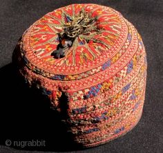Turkmen Baby's Silk Embroidered Hat. Circa 1900. Very fine embroidery with a great range of colours and an amulet. Height 9 cms; diameter 13...
