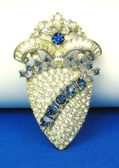 Hattie Carnegie Rhodium Metal and Rhinestone Pin-Hattie Carnegie Lamp-Work Glass Necklace, Ca. 1950  http://www.etsy.com