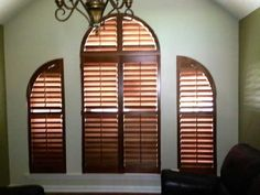 Arched Plantation Shutters By The Louver Shop Stained To Give A  Sophisticated European Feel To This