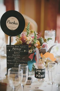 Vinyl record table centre pieces with vintage moustache on stick 'strike a pose' table party pieces http://www.mckinley-rodgers.com/