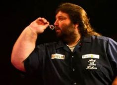'In praise of Human heads and Giant carrots' Stan Skinny : Throwing a Dart in a Bull's eye.