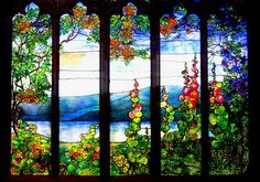 Tiffany glass is a remarkable example of artists being inspired by elements of nature. Lamps, vases, stained glass designed and created by Louis Comfort Tiffany incorporate birds, flora and fauna into the composition of the piece Tiffany Glass, Tiffany Art, Tiffany Stained Glass, Stained Glass Designs, Stained Glass Panels, Leaded Glass, Stained Glass Art, Beveled Glass, Corning Glass