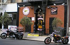 The Hells Angels MC New York City clubhouse, with many security cameras and floodlights on the front of the building
