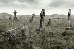 Ancient Celtic gravesite with unmarked gravestones from the 1600's in the middle of a meadow in rural Scotland