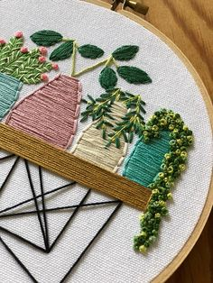 Pot plants in pastel pots on wooden wire table embroidery