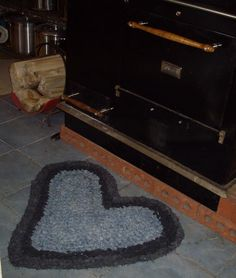 Heart rag rug, crocheted from upcycled jeans.