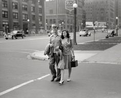 "Michigan Avenue, Chicago, July 1941."" And just a block ago, they were strangers."