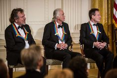 Robert Plant Photos - (AFP OUT) Robert Plant, Jimmy Page, and John Paul Jones (L-R) of the band Led Zeppelin attend the Kennedy Center Honors reception at the White House on December 2, 2012 in Washington, DC. The Kennedy Center Honors recognized seven individuals - Buddy Guy, Dustin Hoffman, David Letterman, Natalia Makarova, John Paul Jones, Jimmy Page, and Robert Plant - for their lifetime contributions to American culture through the performing arts. - President Obama Spends Sunday In Wa...