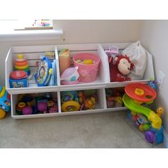 painted wood vegetable crates serve as storage for toys.  costs less than buying those toy storage containers at the store.
