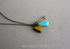 arrow with mustard, umber red and aqua czech glass