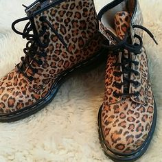 Closet cleanout part 2! Wow! Check out this rare, awesome, vintage pair of leopard patterned Air Wair Dock Martens! Made in England, these are a great addition to a fun closet! I would consider these in pretty much  close to perfect condition!  Size 6 Doc Marten Shoes Combat & Moto Boots