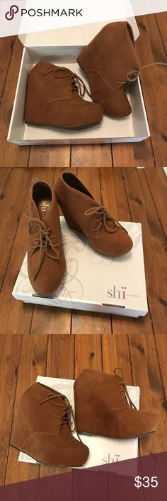 NWOT Brown ShÏ Lace-up Booties NWOT Brown ShÏ Lace-up Booties. Never Worn, comes with Box Shï Shoes Ankle Boots & Booties