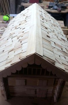 wooden pallet mailbox with shingled roof